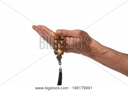 Man praying hands with rosary. Isolated on white background. Religion concept.