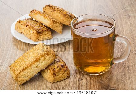 Shortbreads With Nuts And Sesame And Transparent Cup With Tea