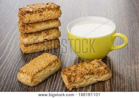 Stack Of Shortbreads With Nuts And Sesame And Milk