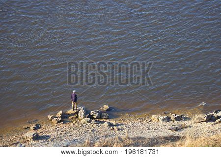 Old Fisherman Sit On River