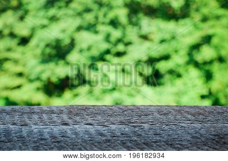 Perspective wood over blur trees with bokeh background, spring and summer season