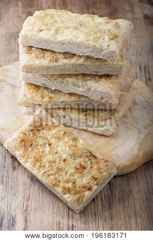 Cheese homemade bread on a wooden board