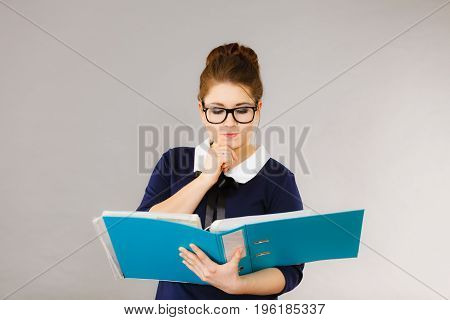 Woman Thinking Holds File Folder With Documents