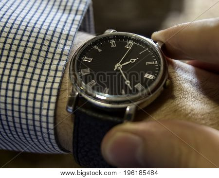 A watch on the hand fingers mechanical watches