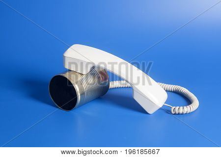 Tin Can Phone With Handset On Blue Background.