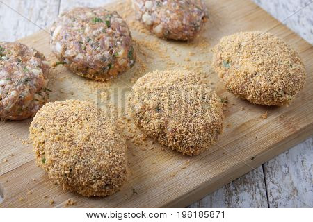 Carrot-meat cutlets with spicy herbs on a cutting board
