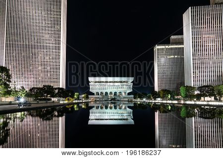 ALBANY, NY - JUNE 28: Reflection of New York State Museum on the Empire State Plaza  at night on June 28, 2017