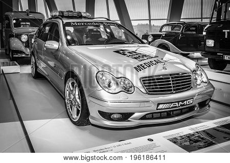 STUTTGART GERMANY- MARCH 19 2016: Mercedes-Benz C32 AMG station wagon F1 Medical car 2001. Black and white. Mercedes-Benz Museum.