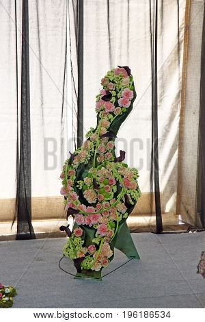 Treble clef made of flowers a flower decoration