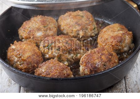 Carrot-meat cutlets with spicy herbs in a frying pan