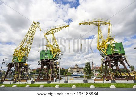 Renovated cranes on the boulevards in Szczecin on a sunny summer day