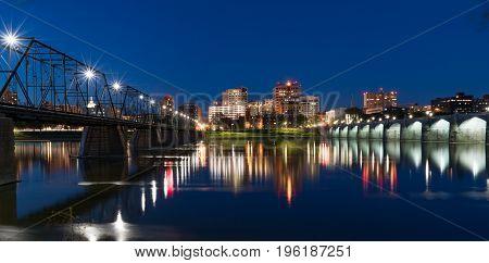 Harrisburg Pennsylvania night skyline reflection across the Susquehanna River