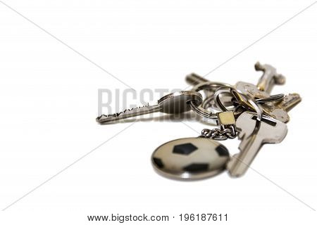Metal keys on a white background with fob soccer