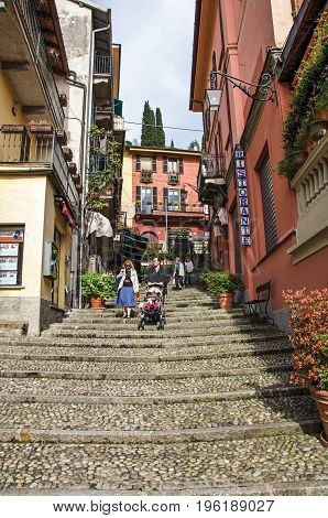 Como, Italy - May 06, 2013. View of alley in hillside, buildings and people in Bellagio, a charming village between the lake and the mountains of Alps. Lombardy region, northern Italy