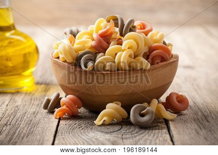 Trottole pasta in a wooden bowl, close-up