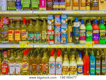 GUAYAQUIL, ECUADOR, NOVEMBER - 2016 - Front view shot os stand with variety of drinks at supermarket