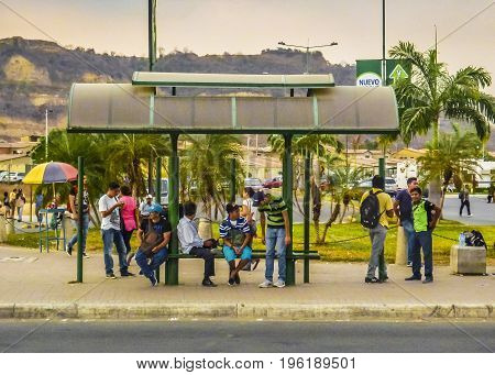 GUAYAQUIL, ECUADOR, NOVEMBER - 2016 - Group of people at stop bus in Guayaquil outskirt Ecuador