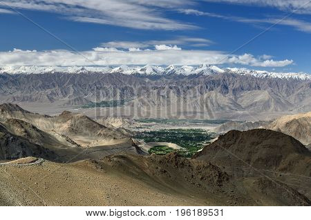 View of Leh from the road to the highest mountain pass in the world that can be reached by car. This pass is the goal of many tourist trips in Ladakh