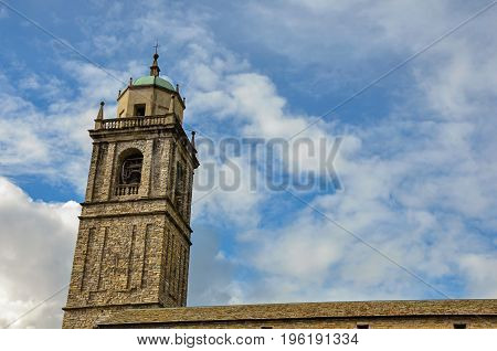Close-up of church bell tower made of bricks in Bellagio, a charming tourist village between the lake and the mountains of the Alps. Located in the Lombardy region, northern Italy