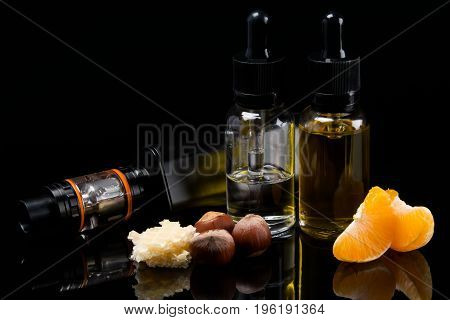 Two flavor liquids with a flavor of waffles with hazelnut and mandarin in a set for Vaping