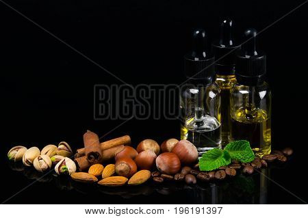 Flavored oils in bubbles surrounded by nuts cinnamon and fresh mint
