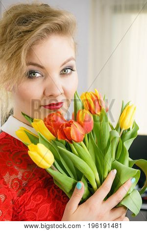 Woman holding bouquet of tulips flowers gift. Womans day 8 march present.