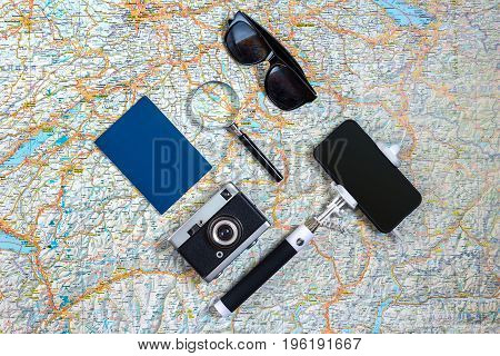 Travel accessories set on white background: smart, passport, map, camera and sunglasses. Top view point. Flat lay. Still life. Copy spase
