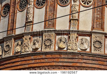 Detail of decoration and sculptures outside the church of Santa Maria delle Grazie, in the city center of Milan, a large and modern city.