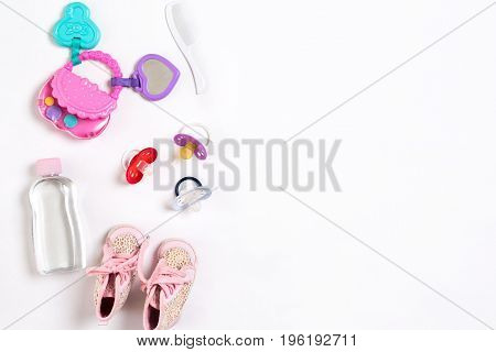 Baby footwear and accessories on white background. Top view. Copy space. Still life. Flat lay