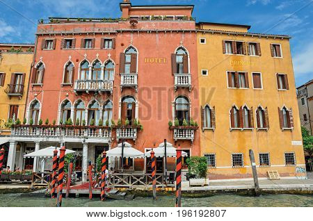 Venice, Italy - May 08, 2013. View of hotel with harbor in front of the Grand Canal. At the city center of Venice, the historic and amazing marine city. Located in the Veneto region, northern Italy