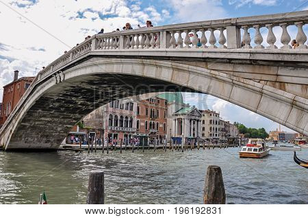 Venice, Italy - May 08, 2013. Bridge view over the Grand Canal, with buildings in the background. At the city center of Venice, the historic and amazing marine city. Veneto region, northern Italy