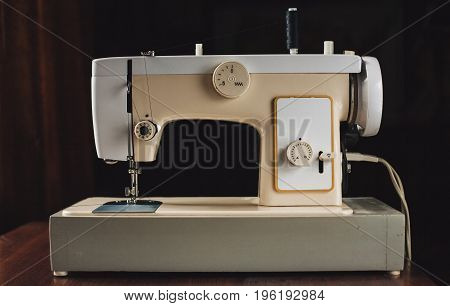 Vintage electric sewing machine on the table