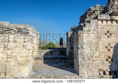 Tourist taking pictures in the Mayan ruins of Becan Mexico