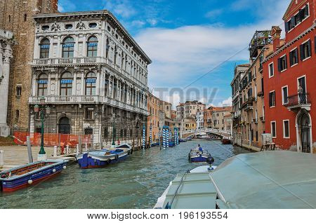 Venice, Italy - May 08, 2013. View of ancient building and bridge facing the Grand Canal, at the city center of Venice, the historic and amazing marine city. Located in Veneto region, northern Italy