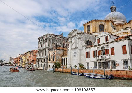 Venice, Italy - May 08, 2013. View of ancient buildings and church facing the Grand Canal, at the city center of Venice, the historic and amazing marine city. Located in Veneto region, northern Italy