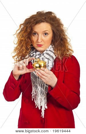 Sad Woman Showing A Small Piggy Bank