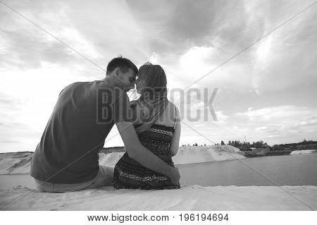 tender lovers on romantic travel honeymoon vacation summer holidays. Young happy couple on the beach. black and white photo