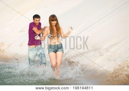 couple running on water. man and woman on romantic travel honeymoon vacation summer holidays romance.