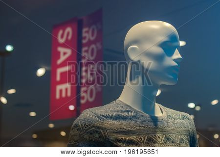 Shopping mall boutique mannequin with clothes on sale male figure portrait selective focus