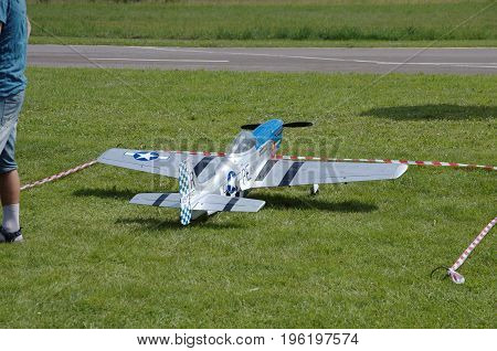 PENZA OBLAST, RUSSIA - JULY 15, 2017: Radio control flying model of North American P-51 Mustang. The Russian Aeromodelling Cup in Bolshoy Vyas village.