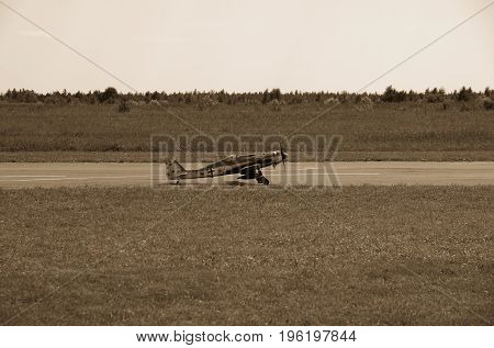 PENZA OBLAST, RUSSIA - JULY 15, 2017: Radio control flying model of Messerschmitt aircraft on runway. The Russian Aeromodelling Cup in Bolshoy Vyas village. Vintage toned photo.