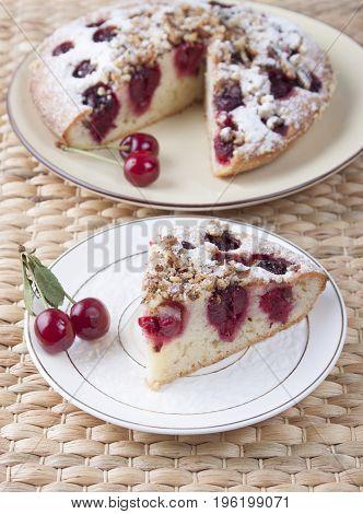Cherry pie with walnuts and powdered sugar