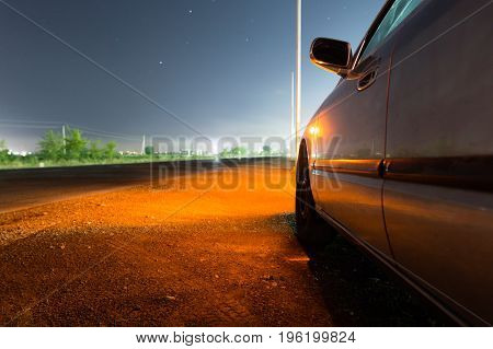 Auto near highway at night as background