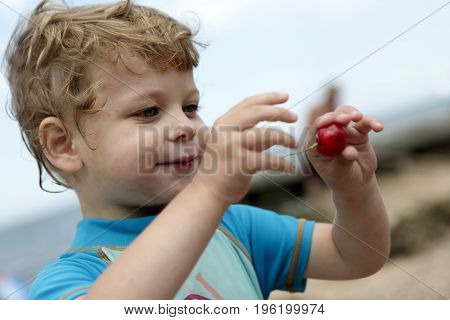 Child With Cherry