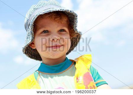 Smiling Boy On Sky Background