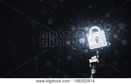 Lock glowing icon pressed with finger on dark background