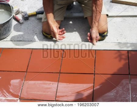 Home improvement, renovation - the building worker is tiled, floor tile ceramic floor tiles