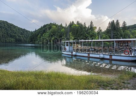 CROATIA PLITVICE, 28 JUNE 2016: Pleasure boats on the pier in the Plitvice Lakes national park.