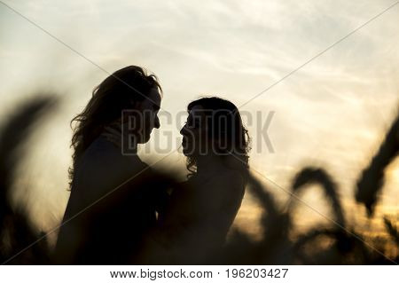 Young happy and romantic caucasian couple at grain field