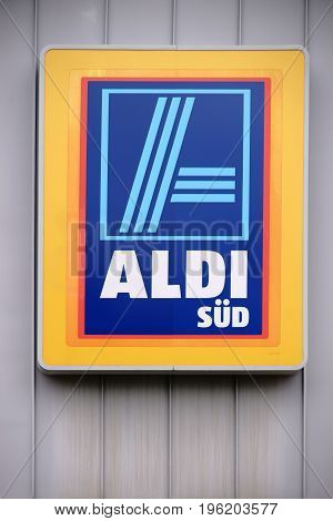 MAINZ, GERMANY - JULY 16: The glowing of the food discounter Aldi South on the facade of a food market on July 16 2017 in Mainz.